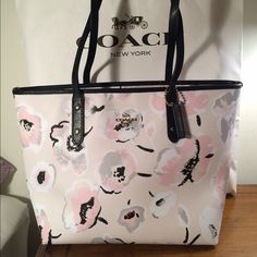 New Spring Collection! Coach City Tote Gorgeous Wildflower City Tote from Coach. Authentic. Ideal tote, with zip top closure. Golden hardware. Fully lined in pale pink color. New with tags attached. No trades Coach Bags Totes