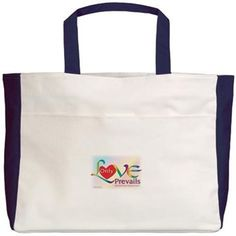 "Only Love Prevails Beach Tote. 00% cotton (14 oz.) canvas Dimensions: 12"" x 16"" x 5¾"" Outside pocket with Velcro® closure Inside pocket with flap Available in 3 colors"