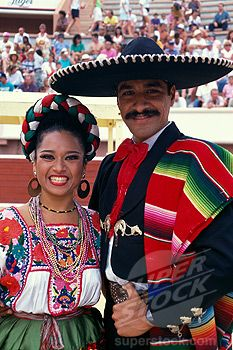 Mexico. Dancers in in full costume.
