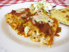 Lasagna Rolls  12 lasagna noodles 24 oz cottage cheese 2 cups grated mozzarella cheese, divided 1/4 cup grated parmesan cheese 1 egg 1 Tbsp parsley 1 jar (26oz) spaghetti sauce 1/2 lb hamburger or sausage