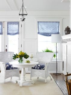 Love the material with the white painted wicker chairs!