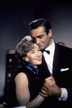 Lois Maxwell as Miss Moneypenny and Sean Connery as Bond Sean Connery James Bond, James Bond Girls, James Bond Movie Posters, James Bond Movies, Uma Thurman, Aston Martin, George Lazenby, Bond Series, Avengers