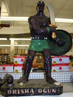 Orisha Ogun statue:  Ogun is the orisha of iron tools and weapons...