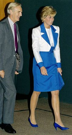 Her Royal Highness, Princess Diana of Wales is escorted by the British Ambassador to the United States Sir Antony Acland, as she arrived at Dulles Airport in Chantilly, Va. to begin her two-day visit to Washington, Oct. 4, 1990. (AP Photo/Marcy Nighswander)