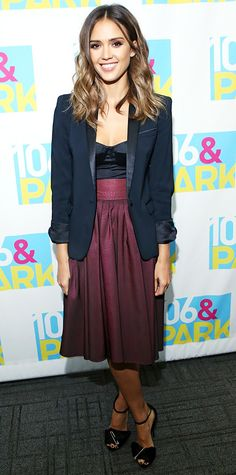 Jessica Alba made a sexy strapless satin bustier top work for the day by pairing it with a full ladylike burgundy Katharine Kidd skirt and navy Kooples blazer. Melinda Maria studs and black ankle-strap Giuseppe Zanotti stilettos rounded out her daytime-appropriate ensemble.