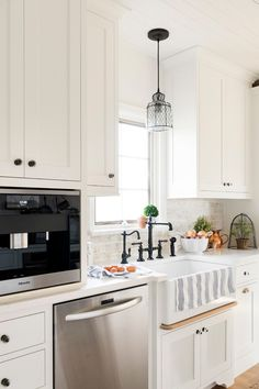 White cottage kitchen with Shaker cabinets and farmhouse sink