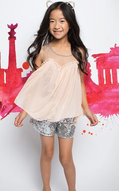 Details Oh you fancy huh? These Sparkle & Shine Silk Shorts have an amazing silver sequin detail with a drawstring waistband. The absolute perfect fit! Pair them with the Simply Sheer High/Low Top and