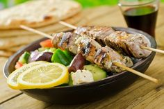 A delicious grilled pork souvlaki served with greek salad, pita, , Best Food Delivery Service, Best Meal Delivery, Restaurant Food Delivery, Food Vouchers, Greek Dinners, Chicken Souvlaki, Souvlaki Pork, Lamb Kebabs, Baking Items