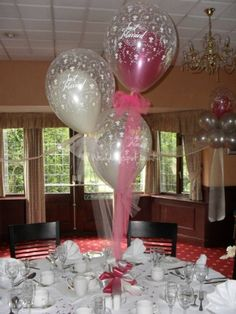 tule as strings for the balloons makes it look dressy. #balloon centerpiece #balloon-centerpiece  #balloon decor #balloon-decor