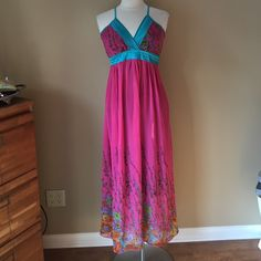 Ga-Pong Maxi Dress Pink and teal blue maxi dress, 65%polyester 35% cotton; lined to about the knee. Adjustable straps, elastic smocked back. No size tag but appears to fit size 3, 6, or small. Shown on size 6/8 mannequin. Check out the $6 section near the bottom of my closet (before the sold items) for lots of bundle-worthy $6 items! 15% bundle discount on 2+ items in a bundle. Ga-Pong Dresses Maxi