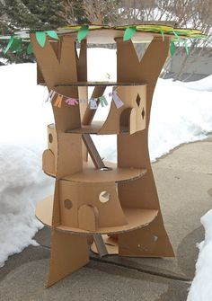 Cardboard treehouse based on Enid Blytons original trilogy that is beloved by millions of children all over the world.  There are three books in the trilogy: The Enchanted Wood, The Magic Faraway Tree and The Folk Of The Faraway Tree.  Hmm, will have to check out the books.