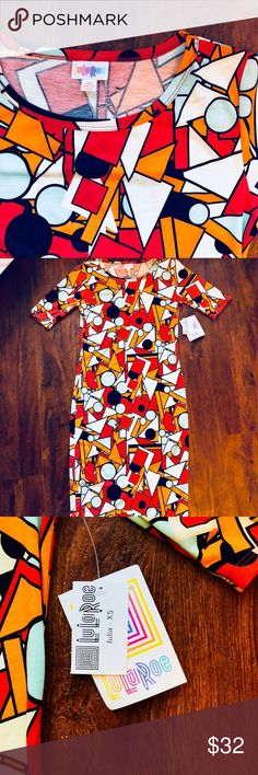 LuLaRoe Julia Cute enough to wear to work, comfortable enough to sleep in. If you've never had a LuLaRoe, just do it. It's so worth it. And at a discounted price, who wouldn't want that?   NWT  96% Polyester 4% Spandex  Offers welcome! ❤️ LuLaRoe Dresses Midi