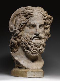 A MARBLE HEAD OF ZEUS AMMON, ROMAN IMPERIAL, CIRCA A.D. 120-160