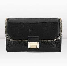 Jimmy Choo - LOU is a functional yet feminine crushed patent leather handbag with one main compartment and a small inside zipped pocket. Featuring a gold chain strap, it can be carried on the shoulder or as a clutch.