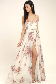 Lulus Exclusive! It's impossible to look anything but exquisite in the Elegantly Inclined Cream Floral Print Wrap Maxi Dress! Lovely blush pink, red, and green floral print woven poly falls from adjustable straps into a princess seamed, wrap bodice (with modesty snap), and a tying waist. Wrapping detail carries into the full maxi skirt.