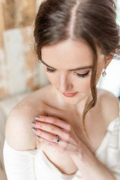 As part of this elegant bride's attire, she wore our Scroll Pattern Engraved Sapphire Engagement Ring in platinum. The blue sapphire adds a pop of colour and the band is hand engraved with our vintage style scroll engraving. Styling: weddingsbyemmalouise.com; Photographer: megandaisyphotography.com #bluesapphireengagementring #engravedengagementring #elegantbride #weddingideas #bridaloutfit