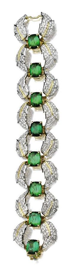 TOURMALINE AND DIAMOND BRACELET, SCHLUMBERGER, TIFFANY & CO.  Set with a row of 8 cushion-shaped green tourmalines within a border of curving leaves, pavé-set with 480 round diamonds weighing approximately 9.50 carats, mounted in platinum and 18 karat gold, length 7 inches, signed Schlumberger, Tiffany & Co.