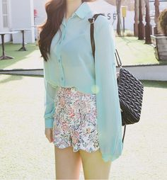 Love the light blue chiffon blouse and the print of the shorts