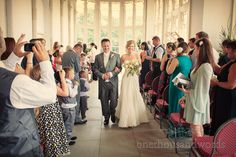 Bride and Groom walk down the aisle at Highcliffe Castle. Photography by one thousand words wedding photographers