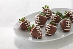 Game Day Strawberries  Our team may not win, but we can at least eat like champs! Simply dip strawberries in melted chocolate and then pipe the white frosting. PC's decorator bottle set works great for the detail work. Visit my website to view them. website! http://new.pamperedchef.com/pws/juliemerda