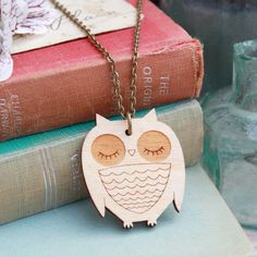 Laser Cut Wooden Owl Necklace by GingerPickle1 on Etsy https://www.etsy.com/listing/117168292/laser-cut-wooden-owl-necklace