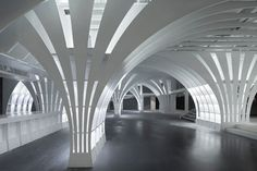 A network of columns and arches frame this toy shop and cafe inside a retail development in Beijing.