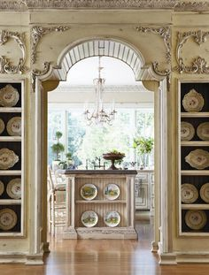 ... WOW. gorgeous, unbelieveable detail in this neutral / cream painted woodwork. French Country kitchen and dining room