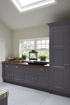 Luxury Kitchens The AGA is the central feature of the Flourish. Nestled underneath a dramatic canopy, it is flanked by elegantly framed furniture. Mudroom Laundry Room, Laundry Room Design, Open Plan Kitchen, New Kitchen, Luxury Kitchens, Cool Kitchens, Kitchen Interior, Kitchen Decor, Utility Room Designs
