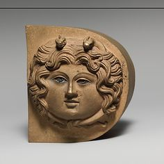 Bronze finial with the head of Medusa