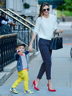 Miranda Kerr.. Parisian chic.. Louis Vuitton handbag, Oliver Peoples sunglasses, Chloe heels, and MCS and Cartier jewelry..