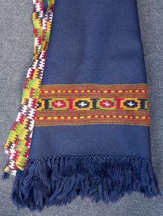 Navy blue pure wool handloom shawl with hand woven coloured border detail. Buy on naggarvalley.com
