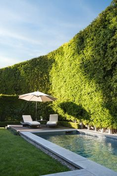 "The 30-foot hedges surrounding the property offer complete privacy. A waterfall shuts out the noise, creating what Metcalfe describes as ""a total oasis."" 