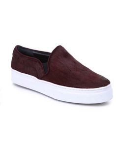 Shop the Schutz Amisha sneaker, featuring a ponyhair upper and platform sole.