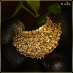 A gold choker with an ethnic design for the woman who proudly carry their culture.