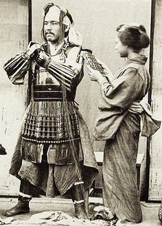 "thekimonogallery: "" Dressing in samurai armor. to Japan. Unknown photographer ""- The wife of the Samurai is helping him with his armor. Japanese History, Asian History, Japanese Culture, Japanese Art, Ronin Samurai, Samurai Armor, Samurai Costume, Japanese Warrior, Japanese Sword"