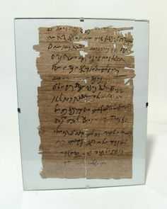 An interesting papyrus text depicting Coptic text on side and Arabic on the…