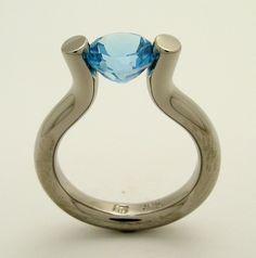 18k nickel free white gold blue topaz tension engagement ring.