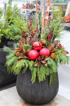 For a unique twist on your Holiday Porch Pot add Various Branches, Ornaments, or Accents~ the creative possibilities are endless!