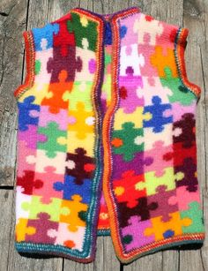 Autism Awareness Puzzle Piece vest crocheted in tunisian stitch with wool and then felted.