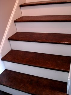 Maybe I could do this to our pesky set of stairs going up to the attic.  Way cheaper than having them carpeted...and cuter!