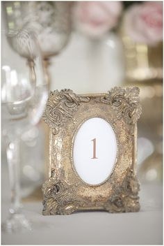 a different vintage picture frame for each table number
