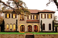 Tuscan Style Homes | Graceful archways and tile roofing give this modern property a ...