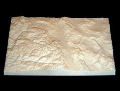 L. The final product - a 3D printed topographic map