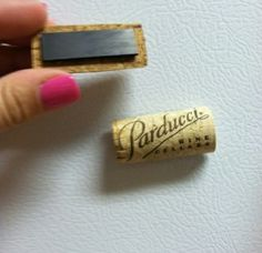Cut a cork in half an then clue a magnet in the back! So cute :)