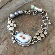 I have made each component of this bracelet in my home studio. The main ocean jasper stone measures 0.75 by just under 0.5 at its widest point.
