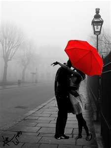 Smooching under the red umbrella