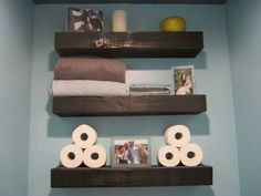 Floating shelves in bathroom above toilet, love this idea