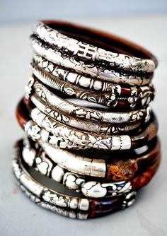 Stack of bamboo and silver bangles