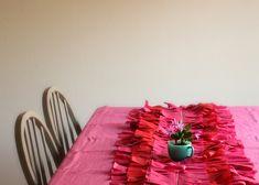 Easy DIY fringe tissue paper table runner or dessert table backdrop {Hank and Hunt}