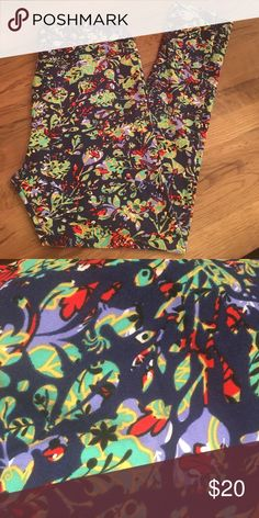 Lularoe TC Leggings. Never worn. Navy blue background with lavender, green, yellow, red and black floral design. Made in Vietnam. LuLaRoe Pants Leggings